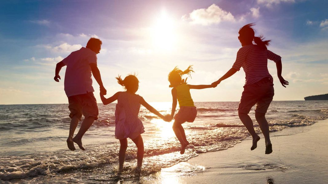 happy family jumping together on the beach?