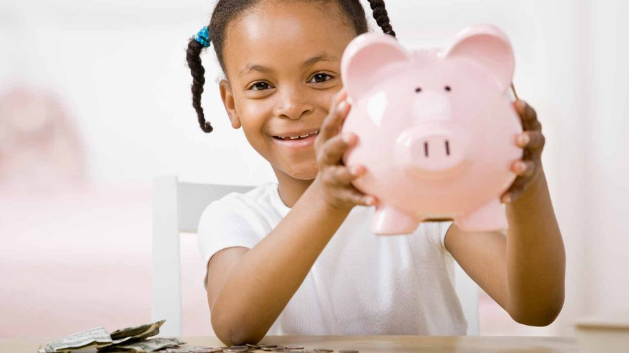 girl with her piggy bank