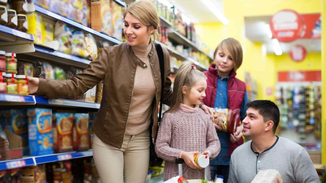 family buying groceries