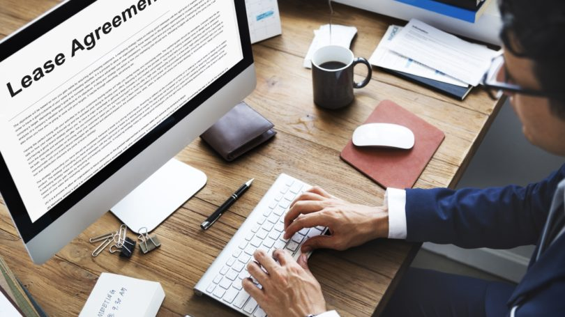 Lawyer Typing Up Lease Agreement Computer