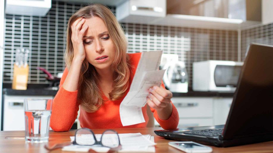 stressed young woman doing banking administrative tasks