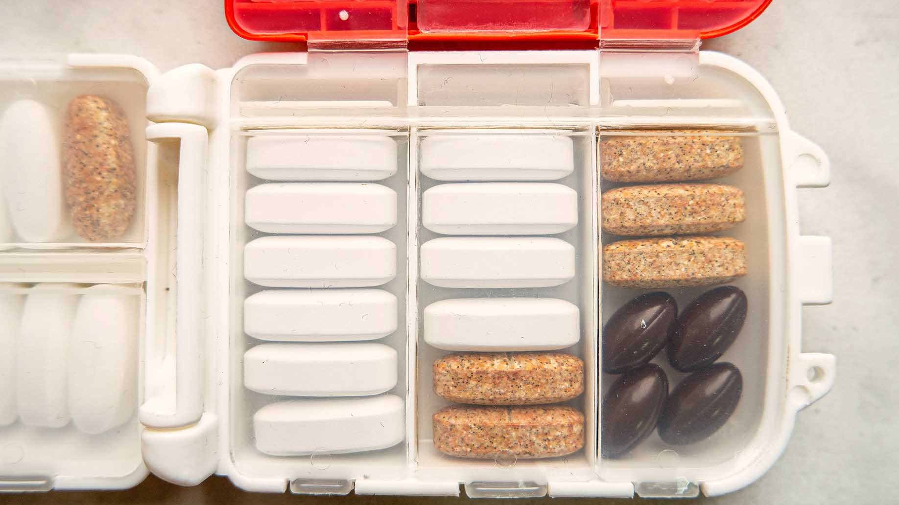 container with pills used for traveling