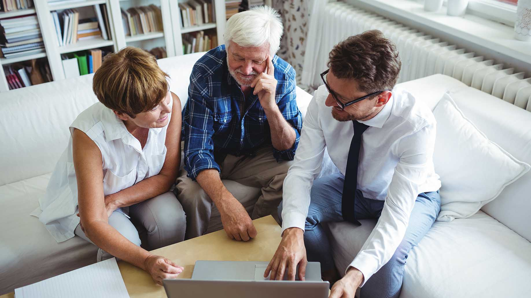 senior couple planning for financial investments with advisor