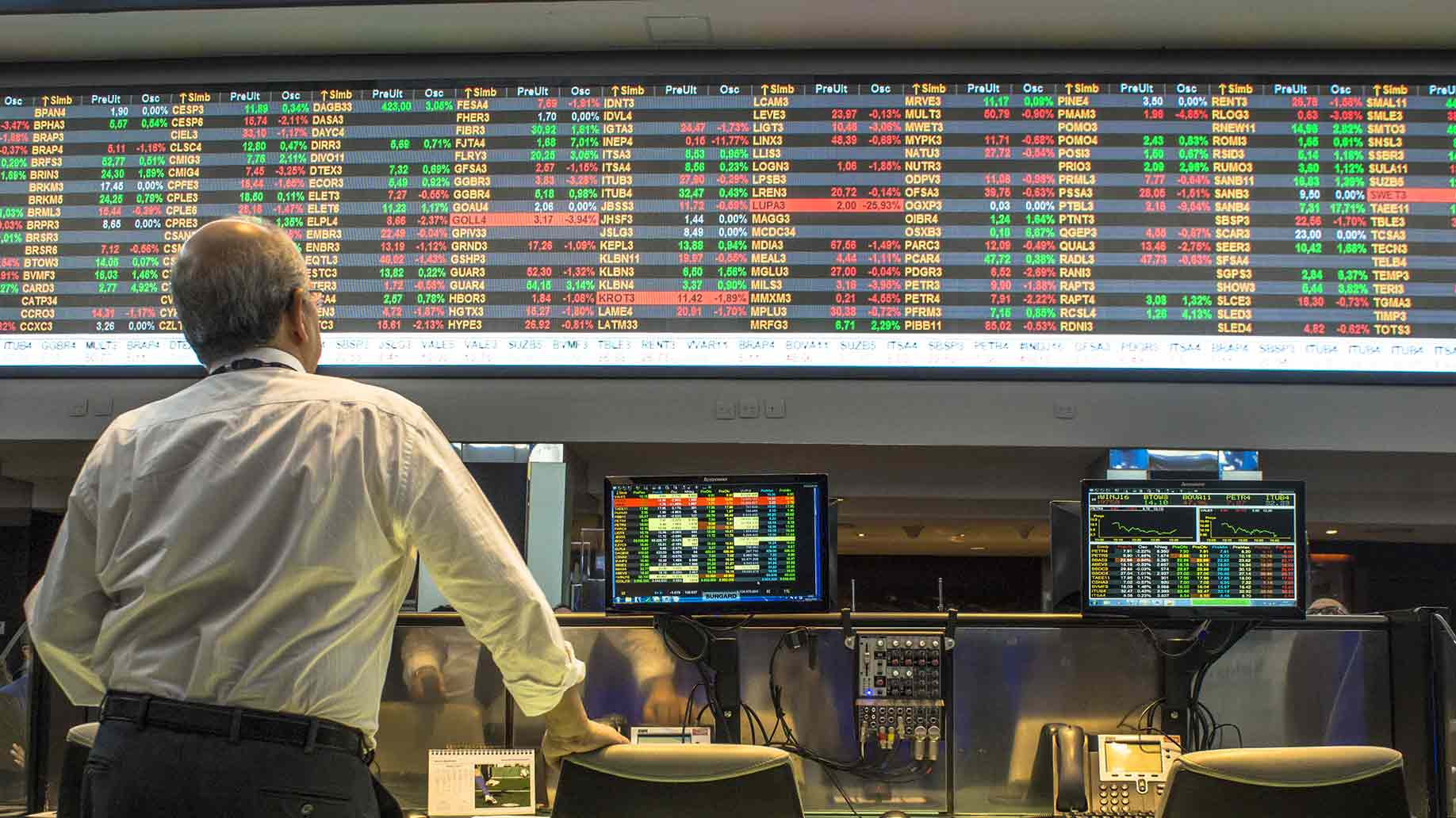 old man watching the stock boards