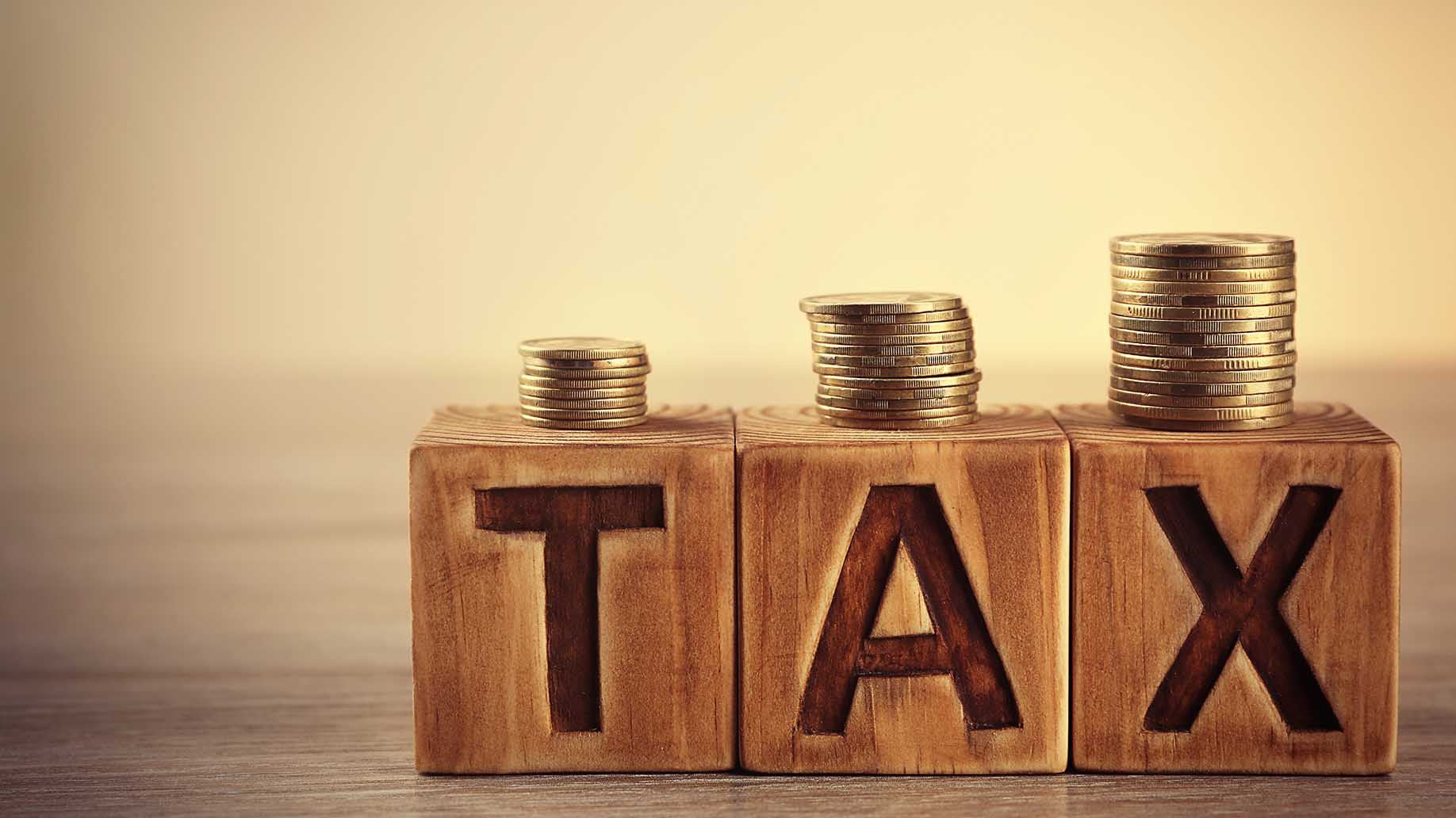 tax concept wooden blocks coins on