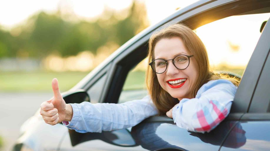 young happy woman sitting car