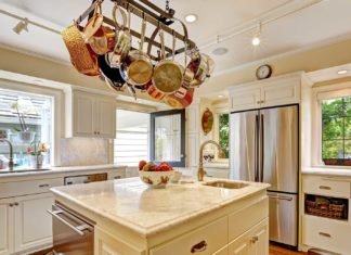 a kitchen with a hanging pot rack?