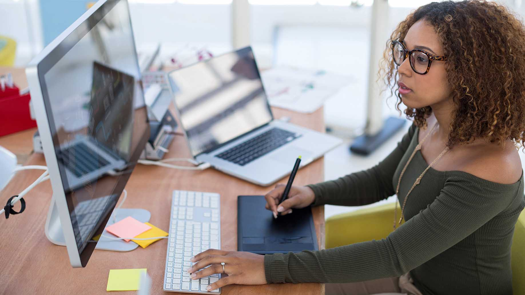 woman using graphic tablet while in the office