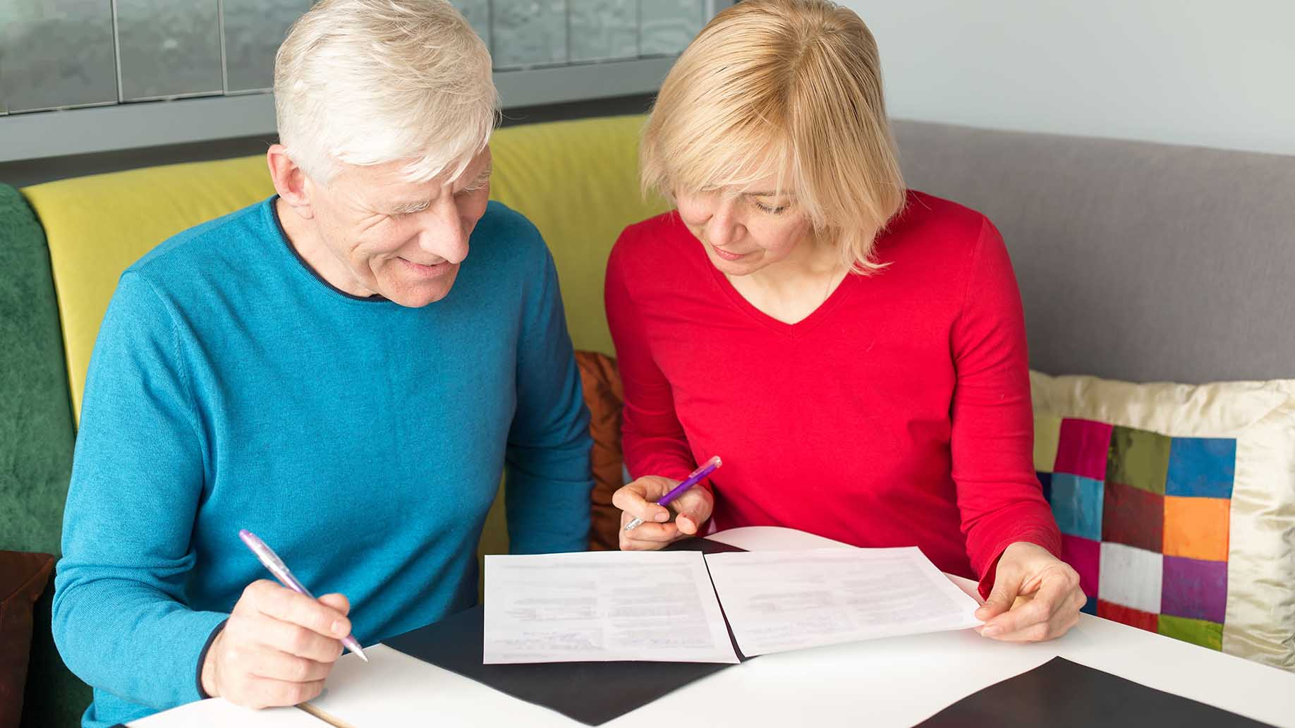 couple reading out documents for pension insurance