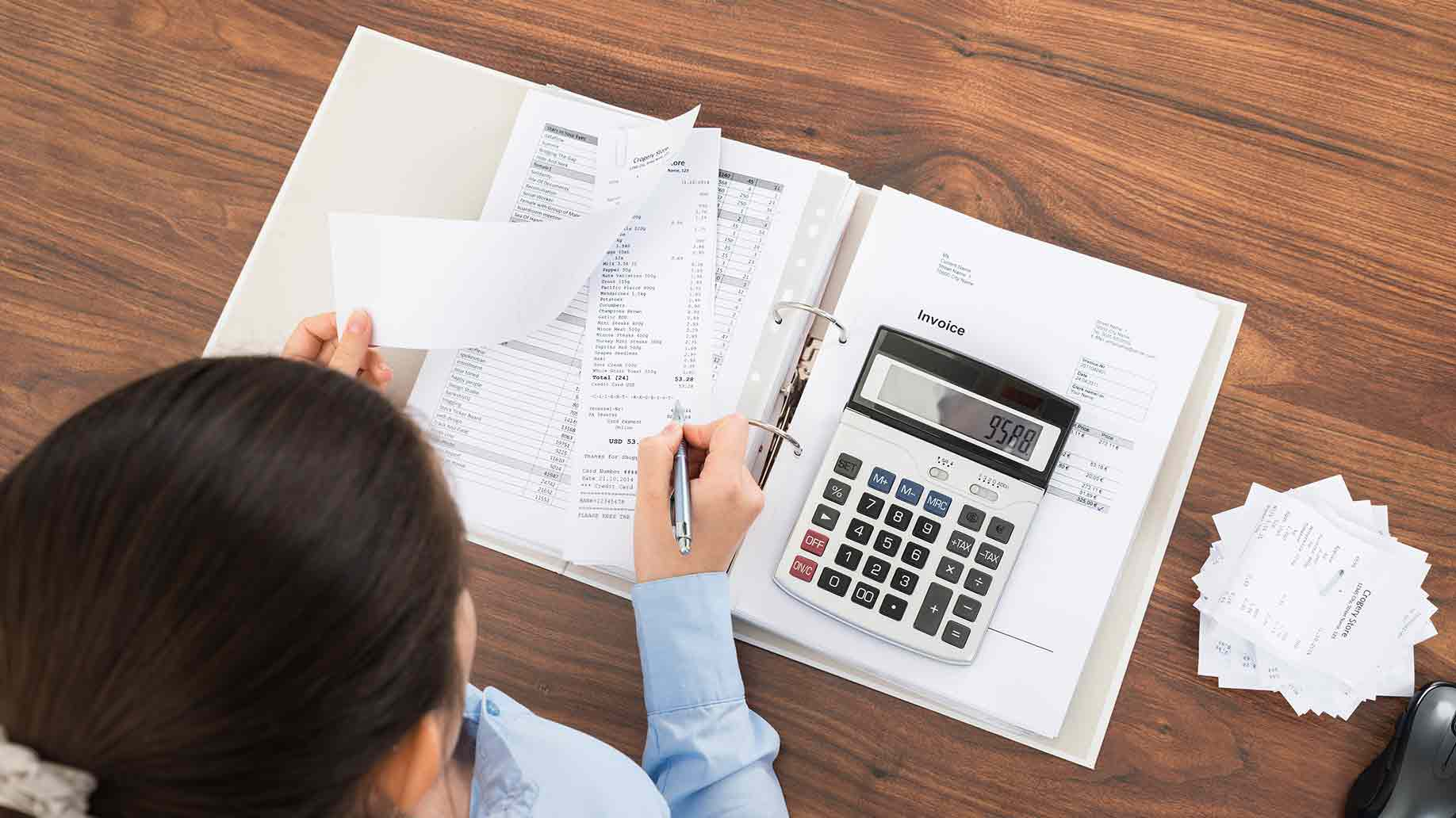 businesswoman calculating tax contributions for roth in office