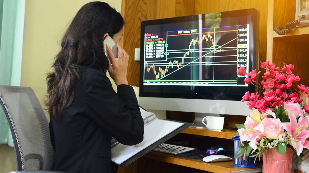 businesswoman is working with finance trading stock