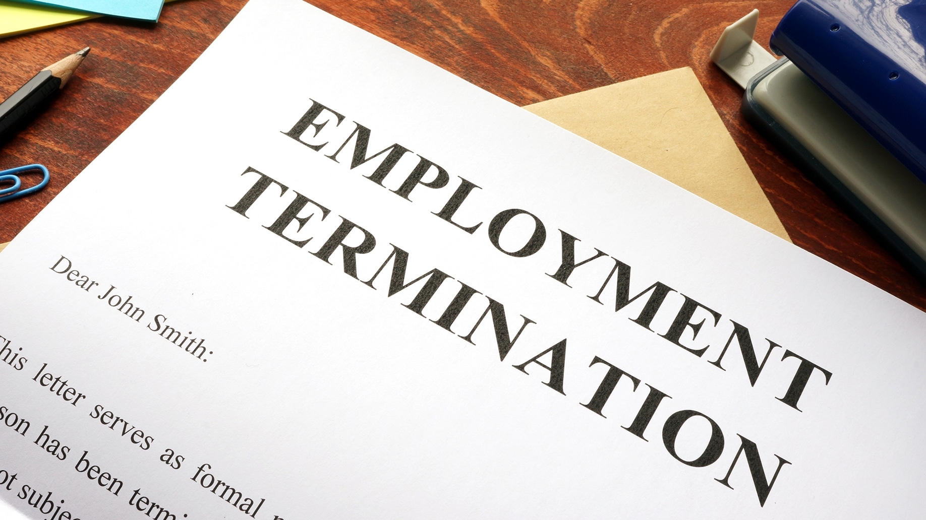 employment termination letter at top of table