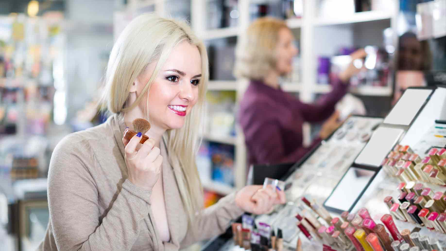 Girl visit cosmetic store choosing face powder