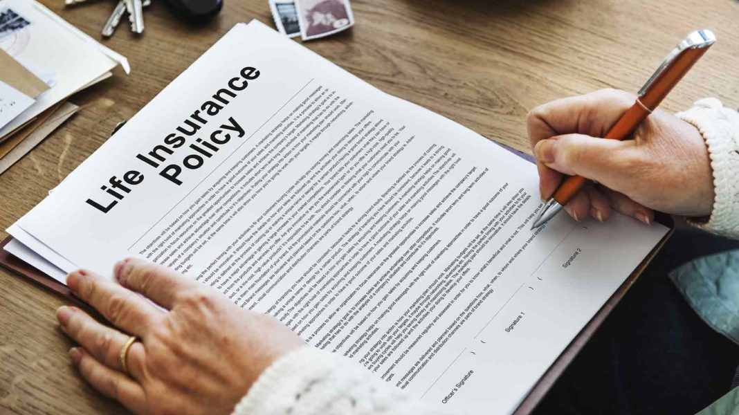 life insurance policy documents at top of table