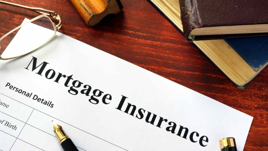 mortgage insurance policy with a book and a pen