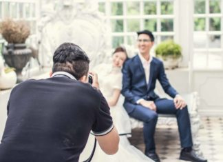 wedding photographer with bride and groom