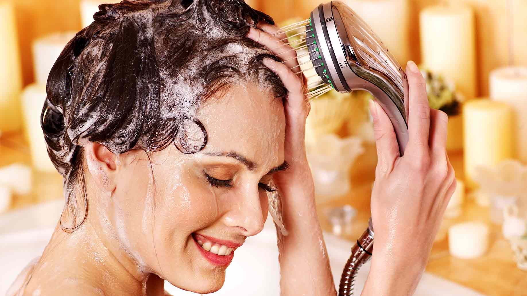 bride washes her hair in the bathroom