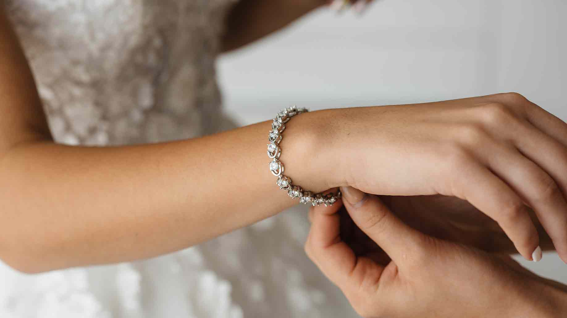 beautiful bride wearing a bracelet on her arm for her wedding