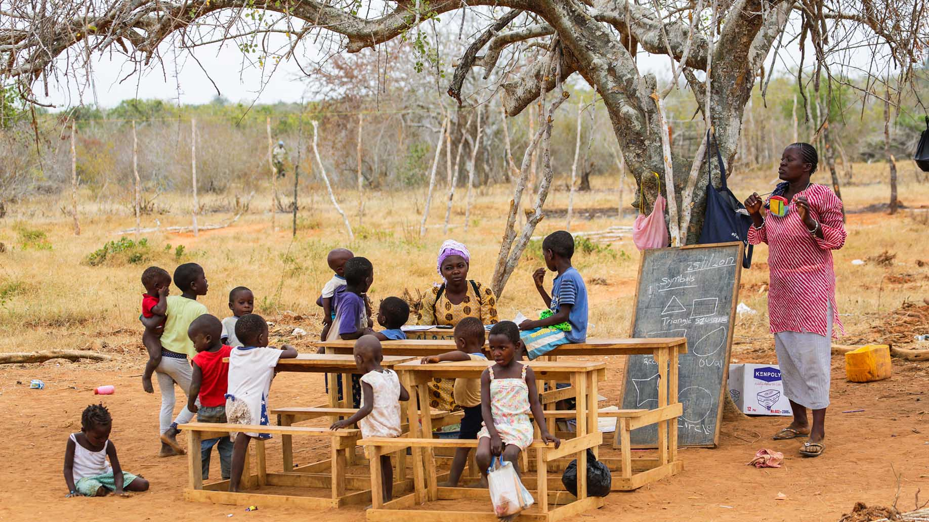children from small local village attending open air primary school