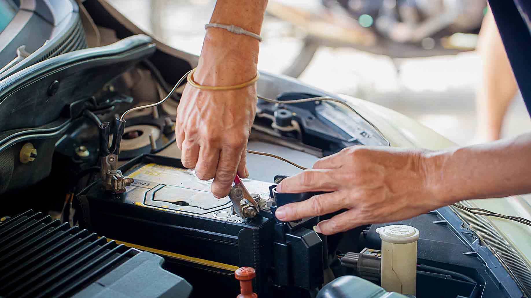 Depleted Battery Changed By Mechanic For Car Maintenance