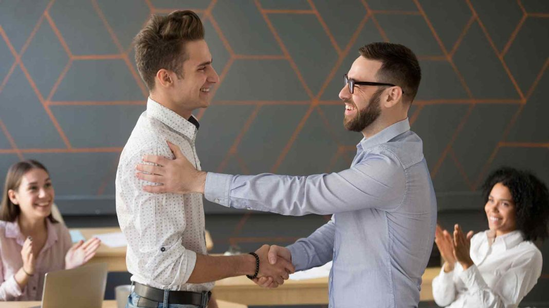 employee congratulating with professional achievement