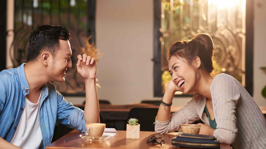 side view portrait laughing asian couple?