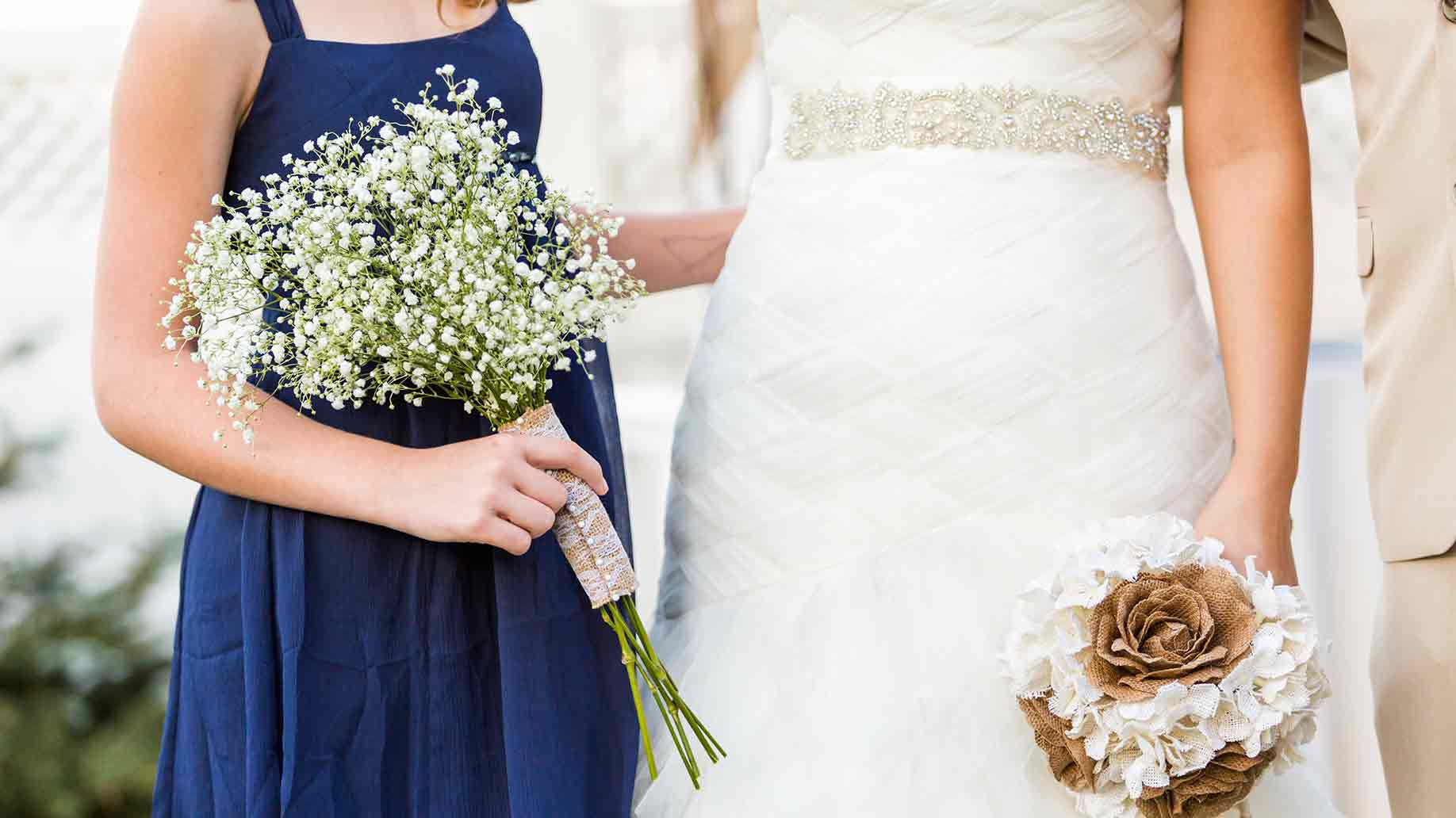 small wedding ceremony with two ladies in white and blue theme
