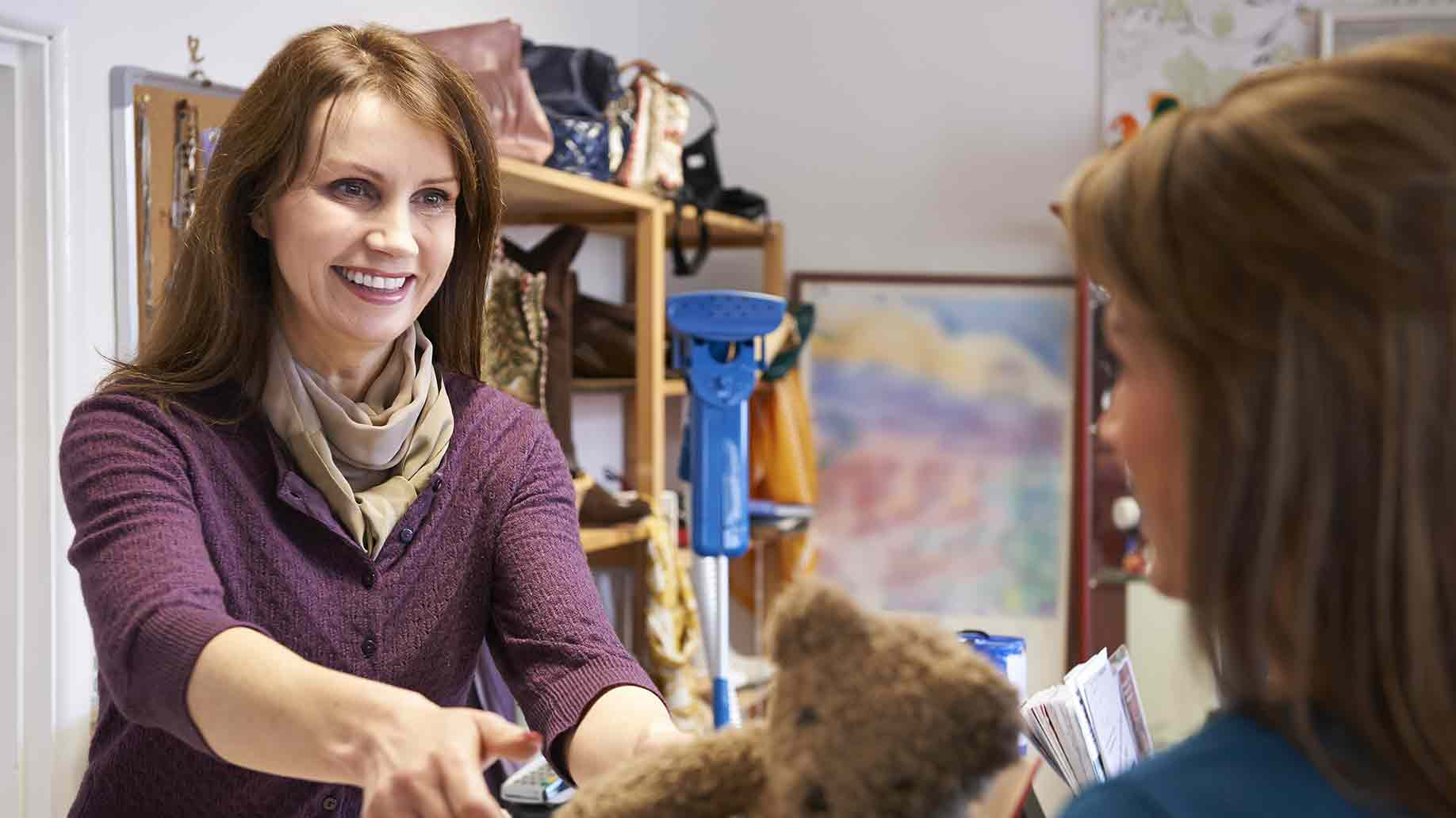 woman donating unwanted items charity shop