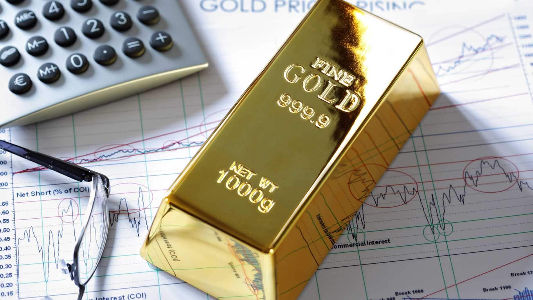 gold ingot resting on stocks shares