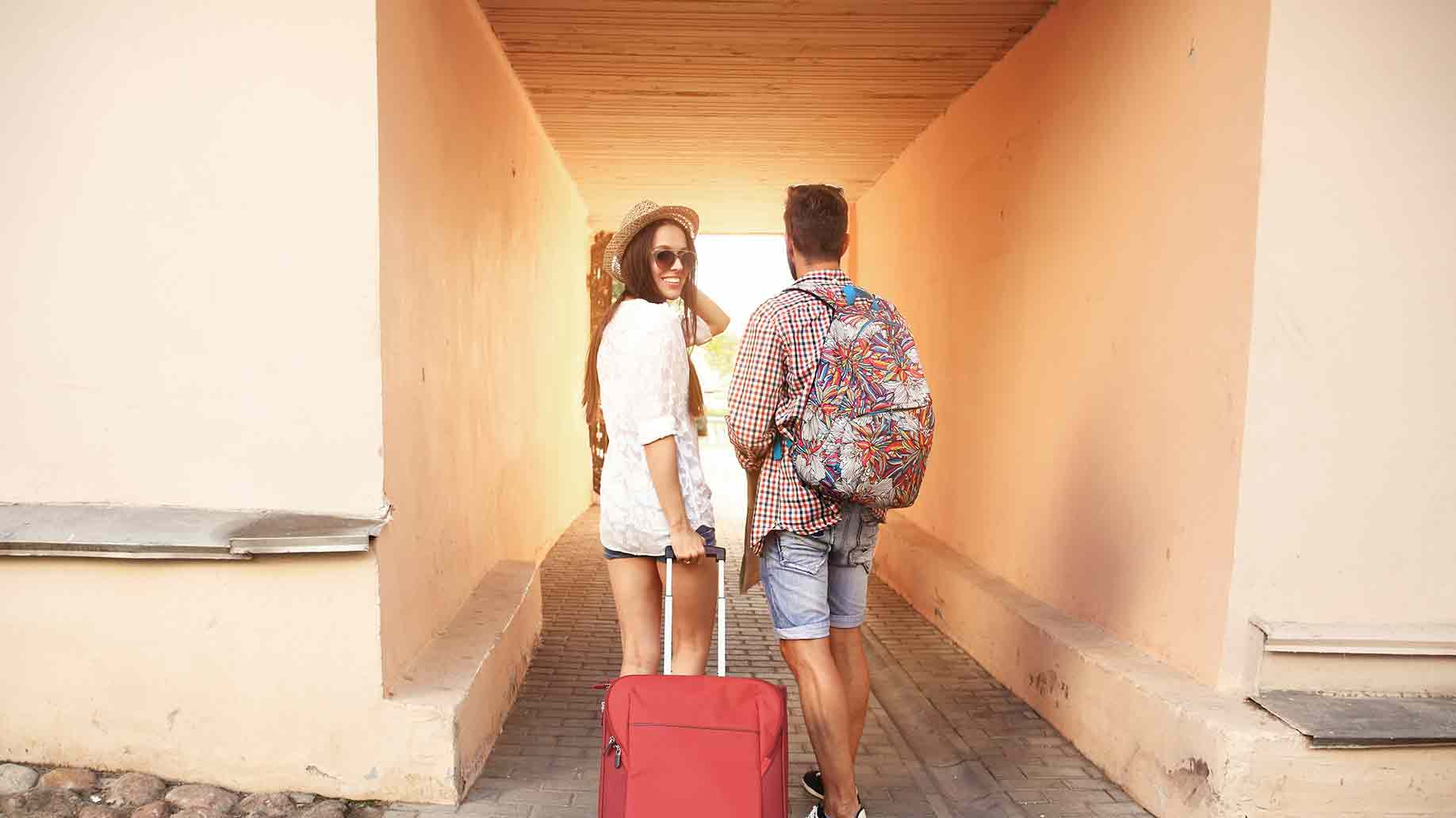 two travelers on vacation walking around