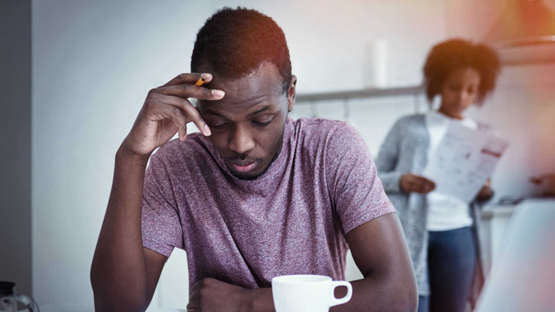 unhappy african american family financial stress