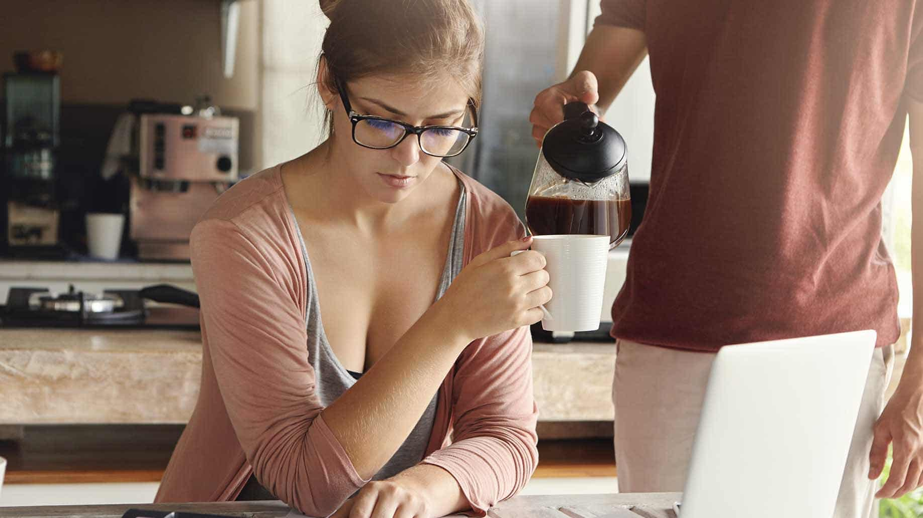 worried young woman calculating family expenses