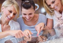 girls having fun while shopping in jewelry store