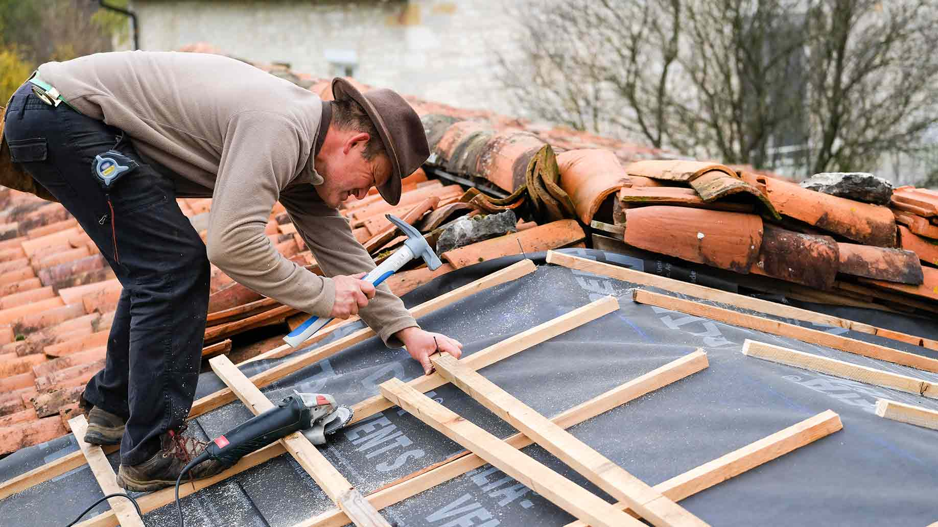 construction worker renovating roof covering