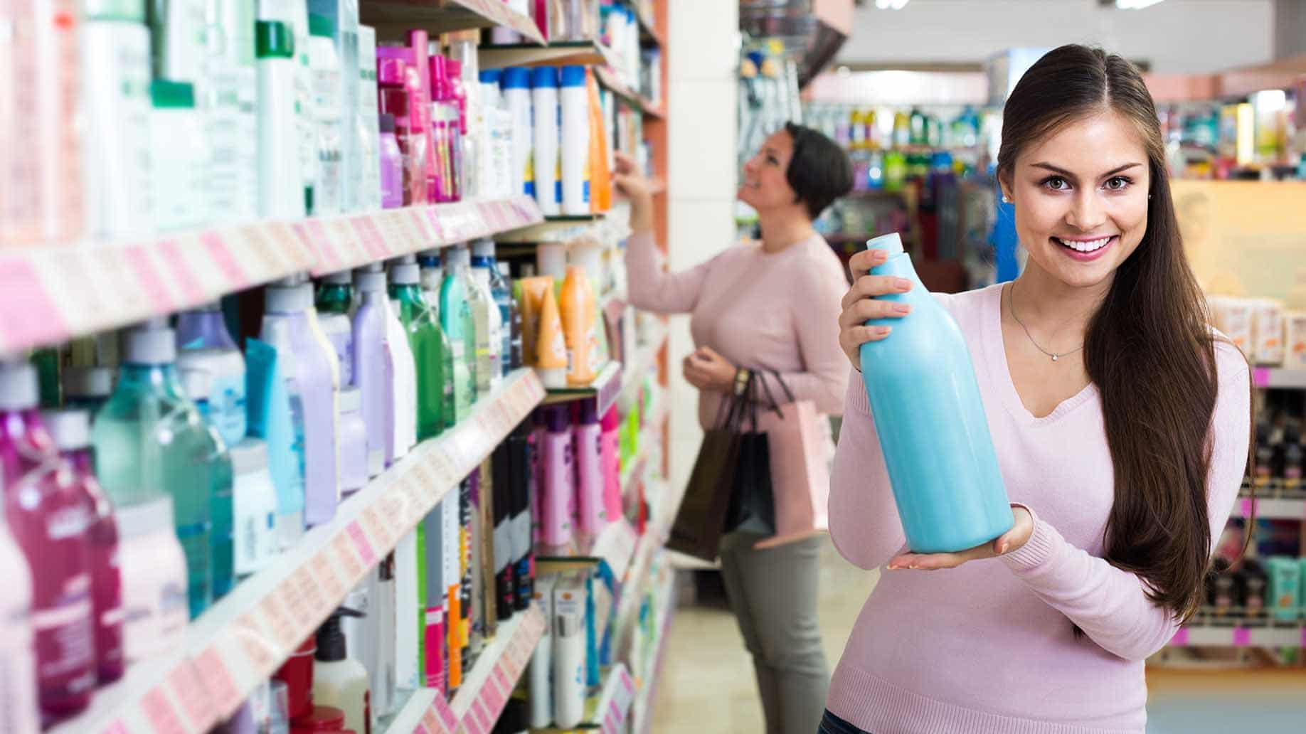 woman checking shampoo bottles