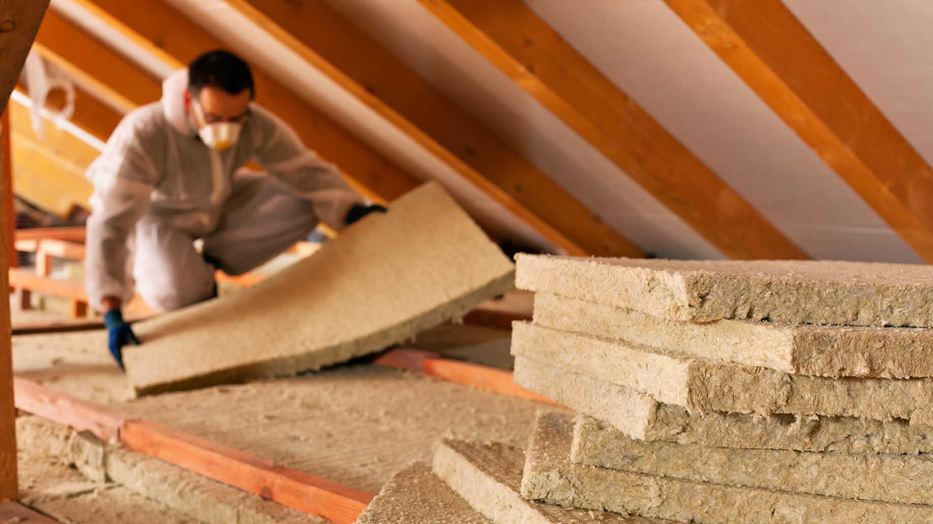man installing thermal insulation layer