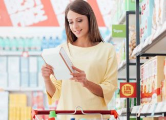 young woman doing grocery shopping supermarket