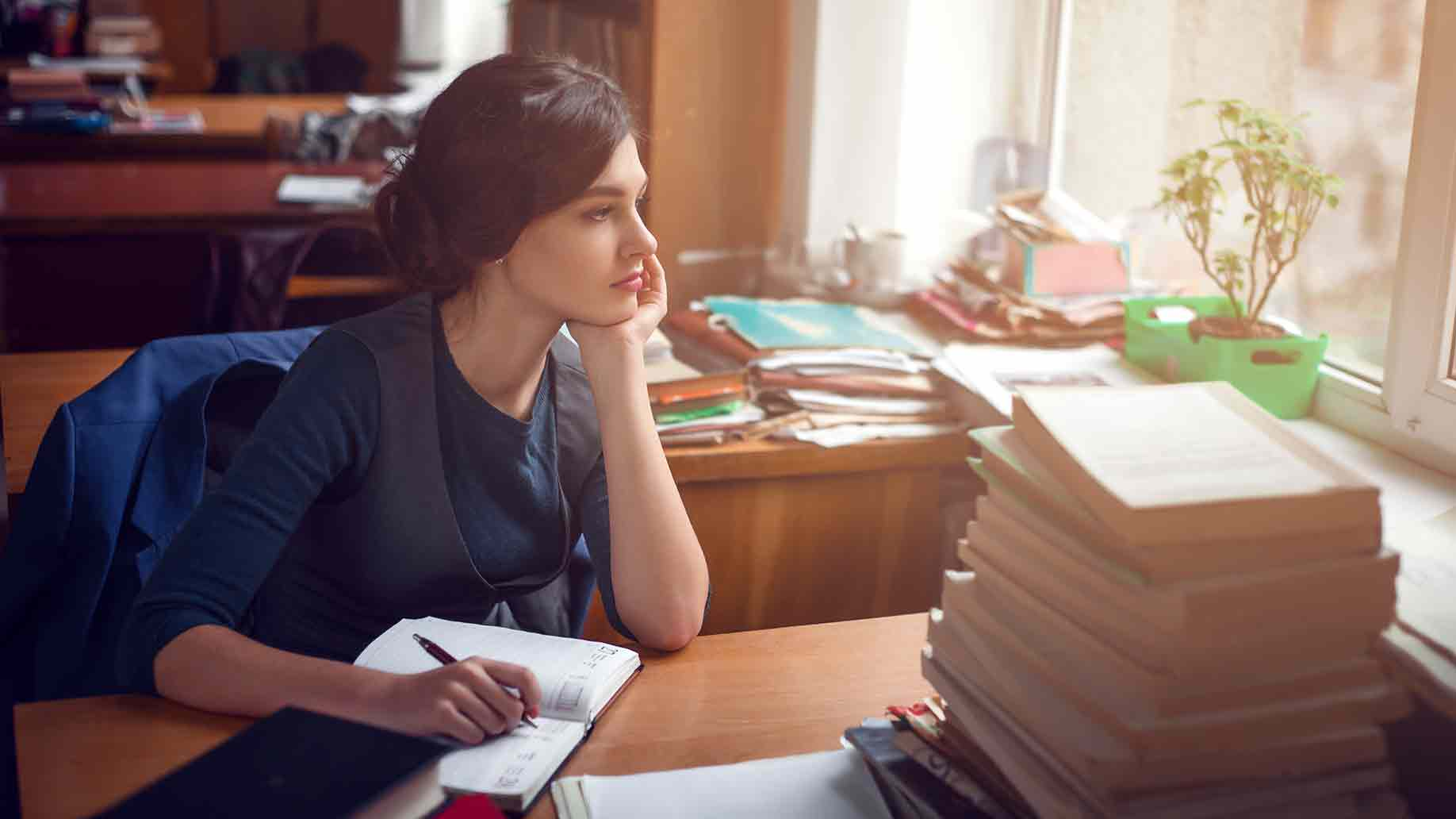 serious woman thinking library silence