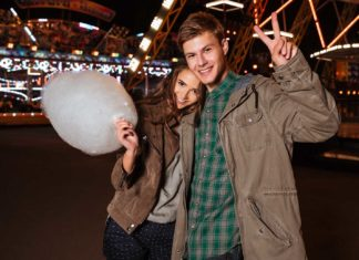 cheerful young couple holding cotton candy?
