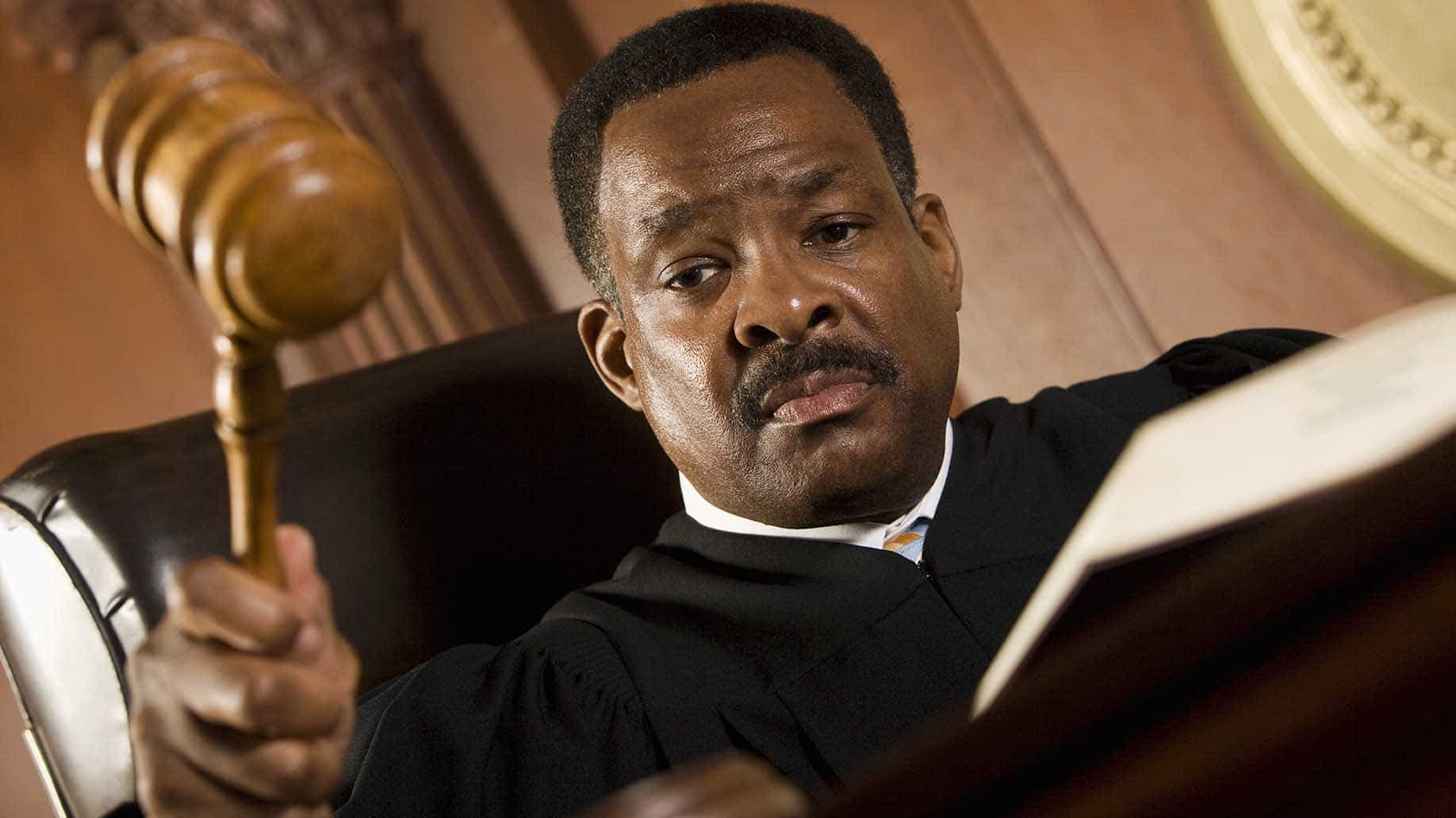 african american judge pounding mallet courtroom