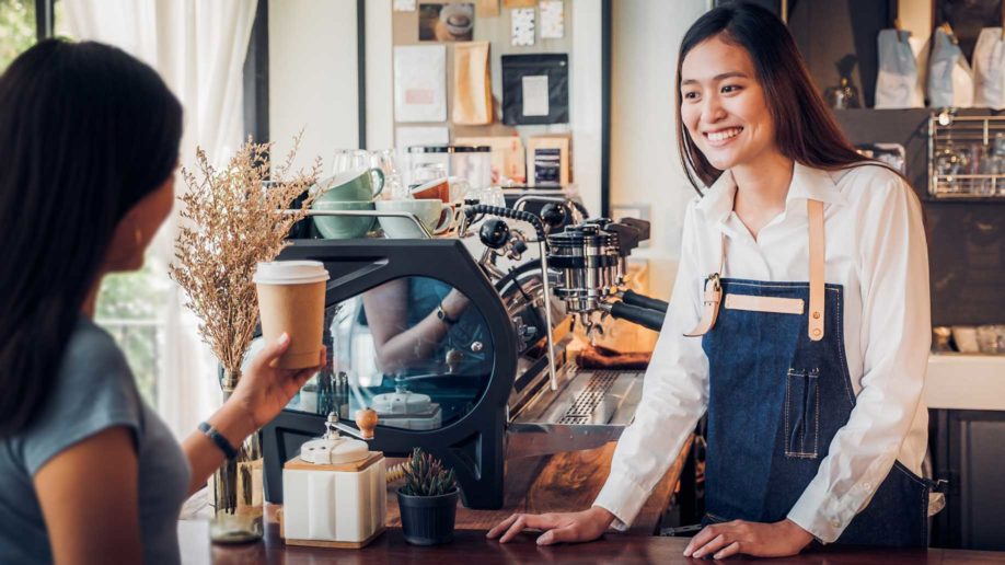 asian woman barista wear jean apron?