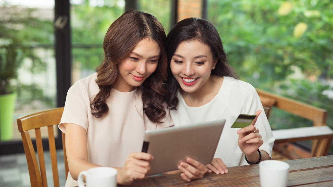 cheerful young women using digital tablet?