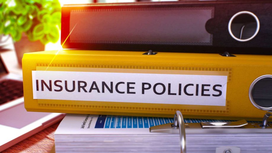 insurance policies yellow ring binder on?