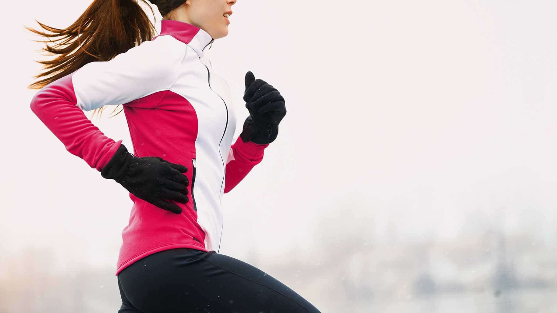 winter running athlete woman on cold