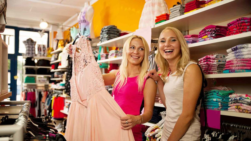shopping clothes store two cute women