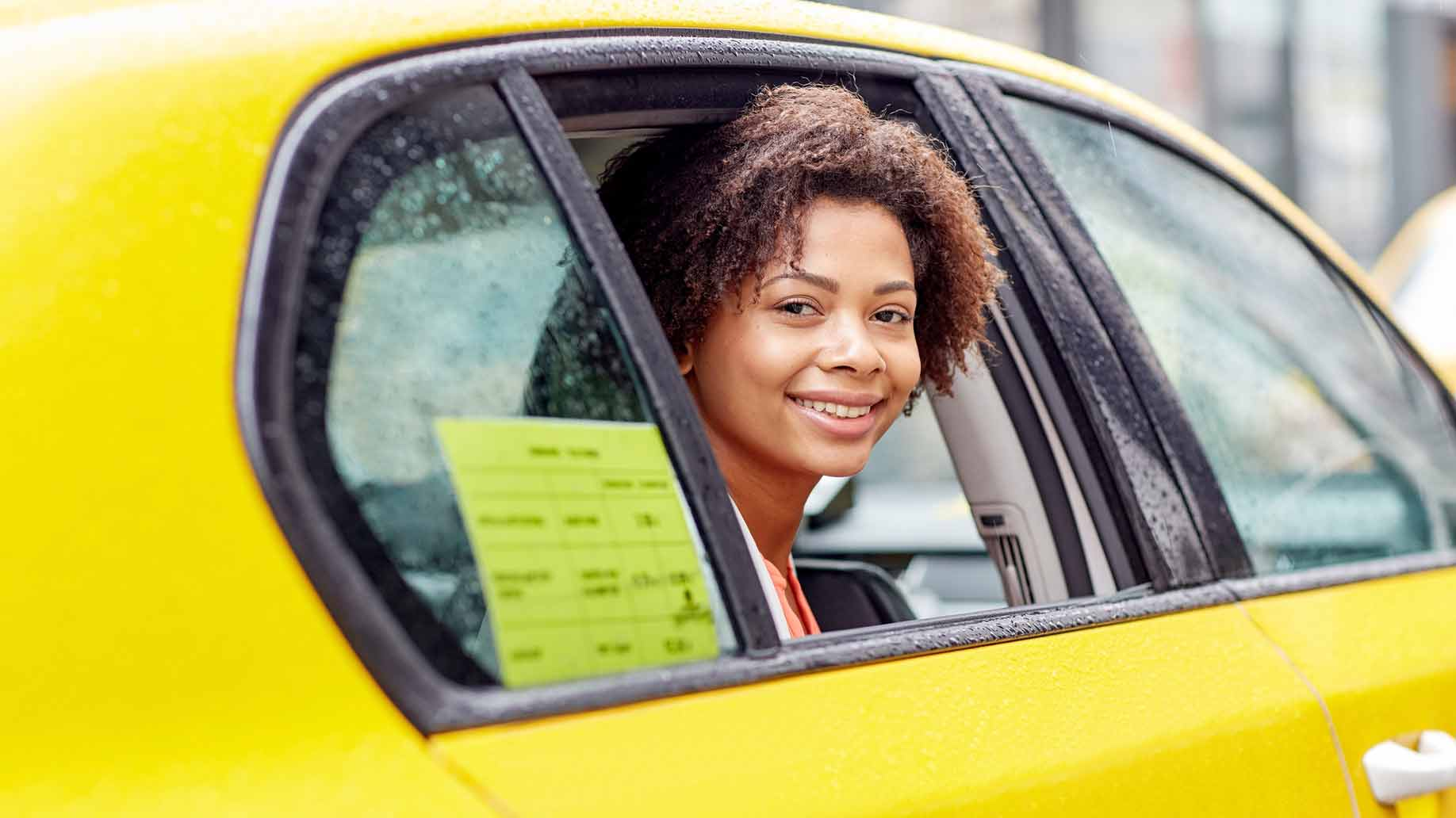 woman in a taxi cab