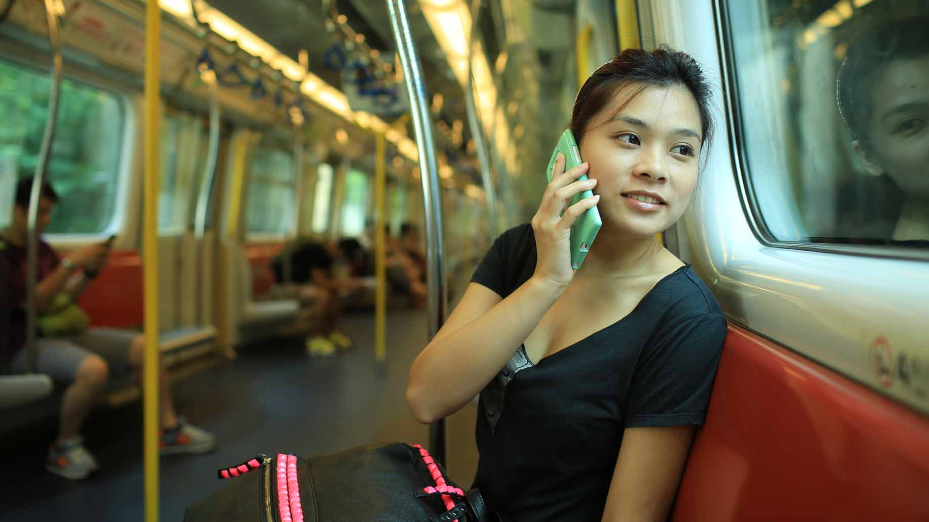 woman on phone riding the subway