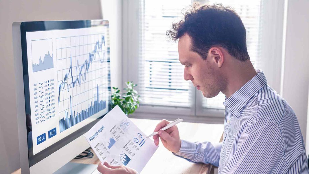 trader analyzing financial report trading charts?