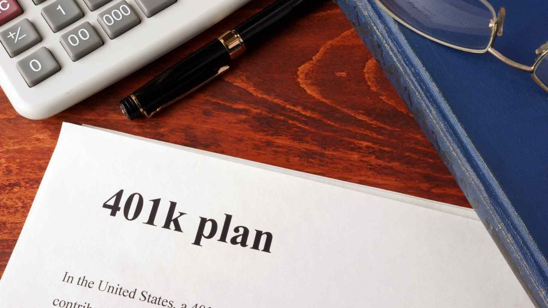 papers 401k plan book on table?