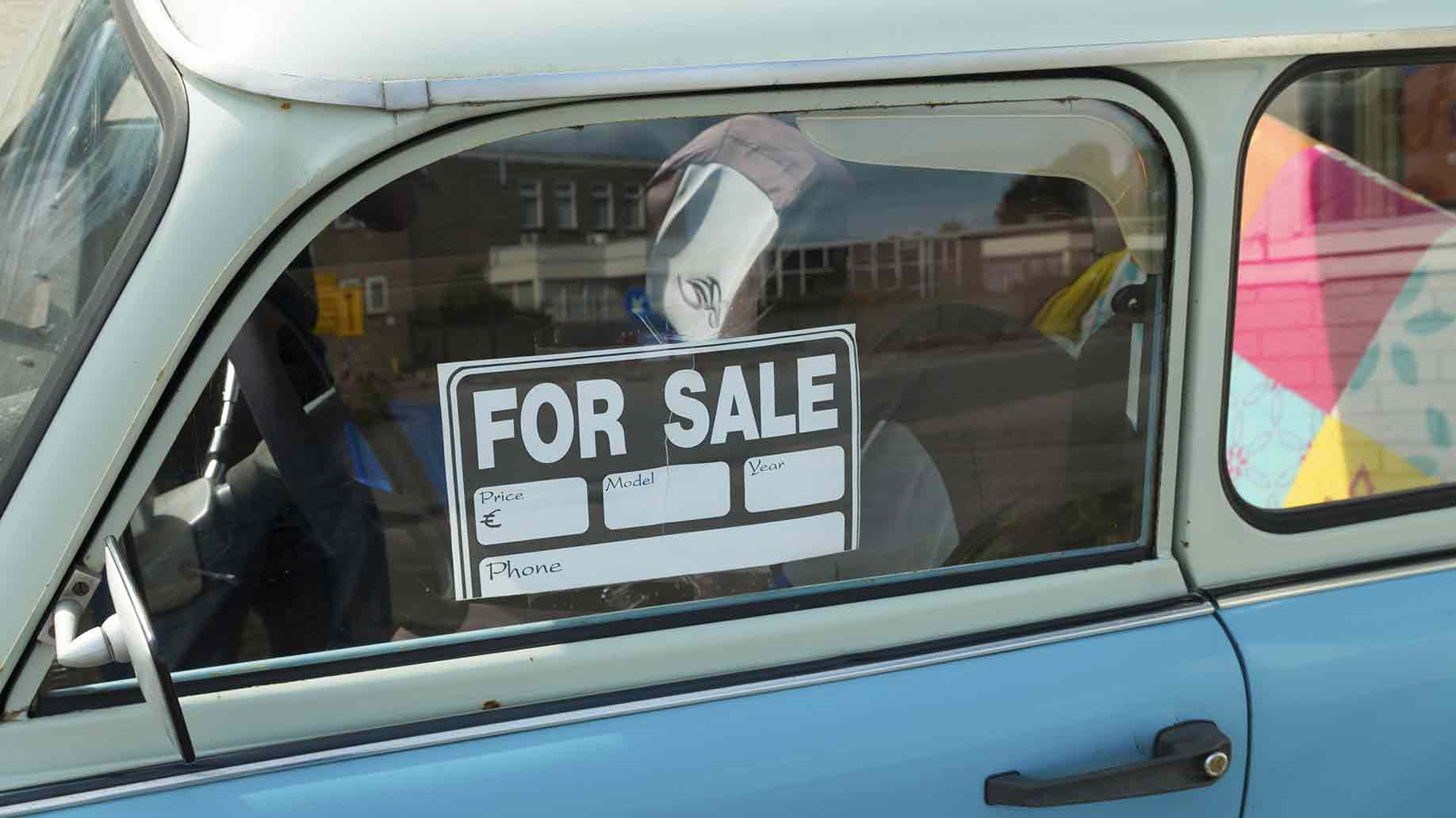 sale sign on car